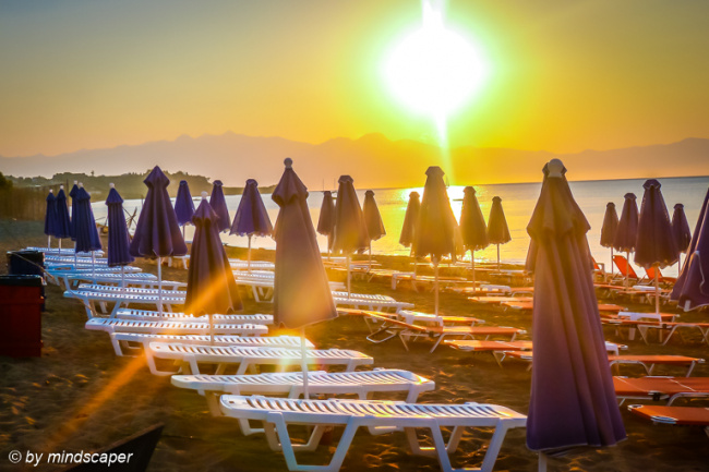 Umbrellas in the Sunrise - Sea and Sun Story