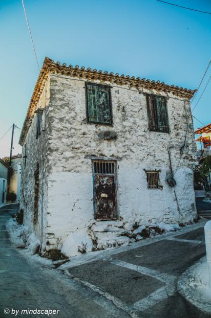 Old House with Black Door and Windows - Vasilitsi