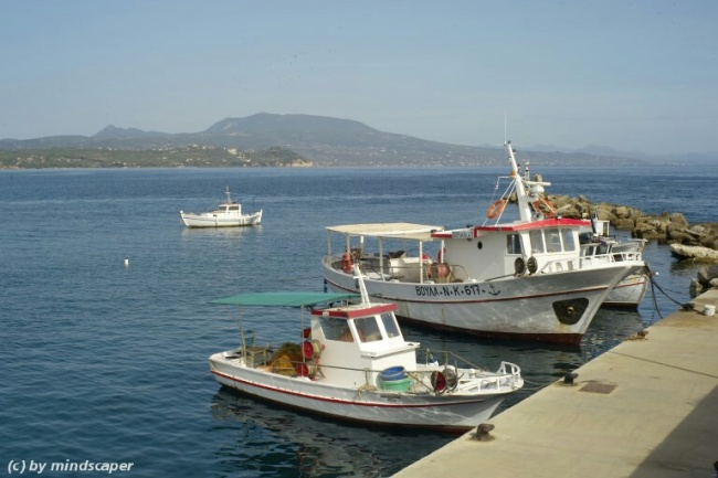 mole with fishing boats